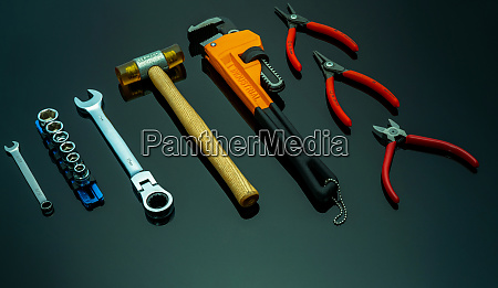 set of mechanic tools on black
