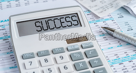 a calculator with the word success