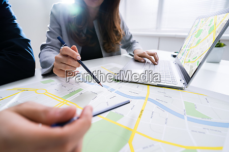 two people looking at city map