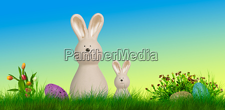 two easter bunnys stand on a