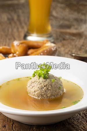 bavarian liver dumpling soup on wood