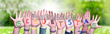 children hands building word geburtstag means