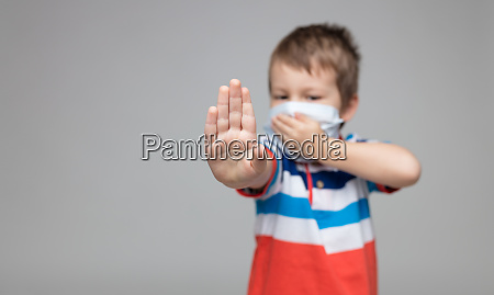 young child wearing a respiratory mask