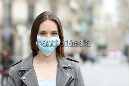 woman with protective mask looking at