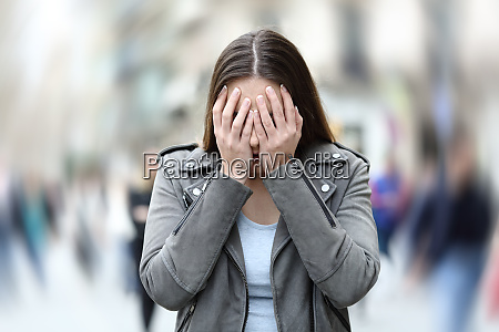 woman suffering anxiety attack on city