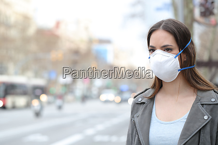 woman wearing protective mask looking at