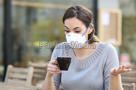 confused girl holding a cup of
