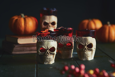 close up of human skull candles