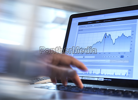 stock broker analyzing the performance of