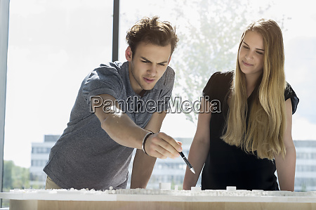 two young architects standing at a