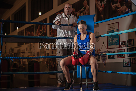 portrait of boxing coach and female