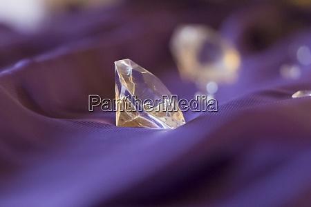 luxury valuable gemstones diamonds on purple