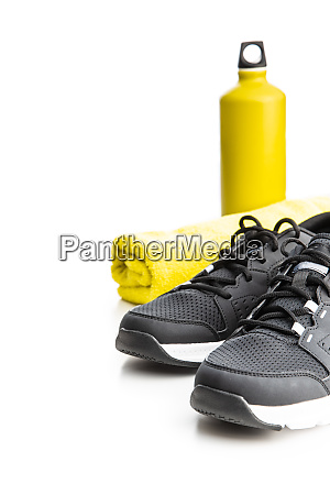 black sports shoes towel and bottle