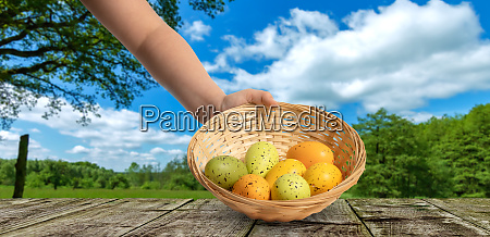 hand holds an easter basket with
