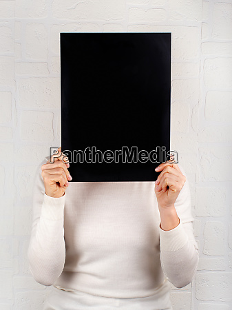 woman keeps in hands a black