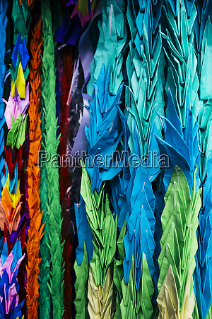 close up of colourful origami cranes