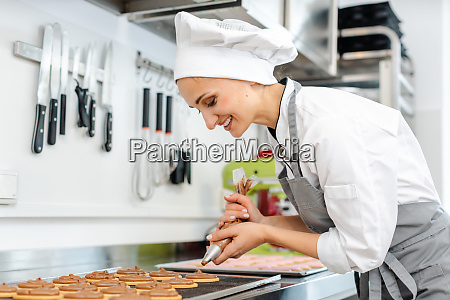 confectioner woman using pastry bag to
