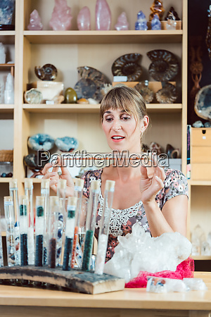 young woman working with gemstones as