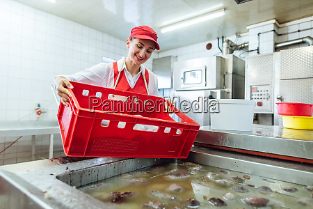 woman working in butchery about to