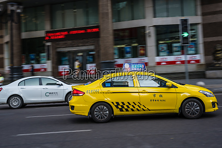 yellow taxi on the street in