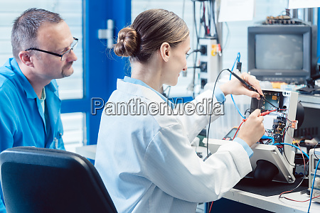 team of electronic engineers testing a