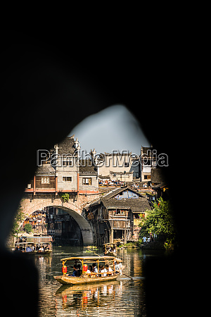 tourists in old wooden boat in