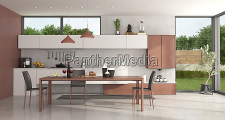 modern kitchen with dining table and