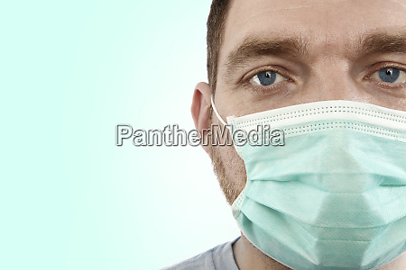 closeup of a doctor with green