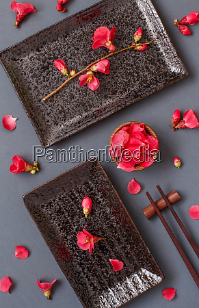 chopsticks rectangular plates and pink flowers