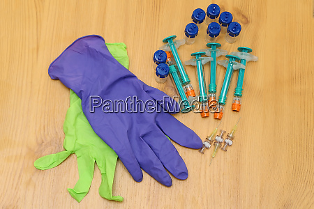 gloves with vials and injections