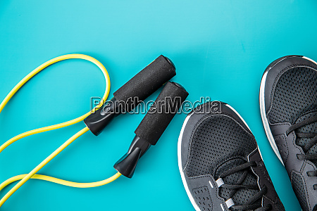 black sport shoes and jump rope