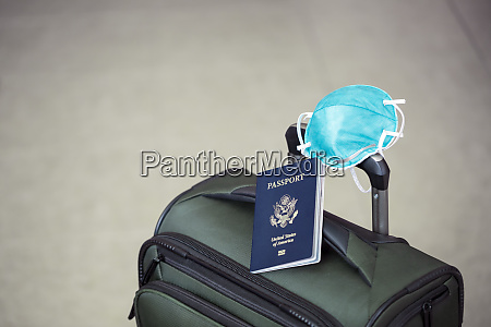 personal luggage with passport and flu