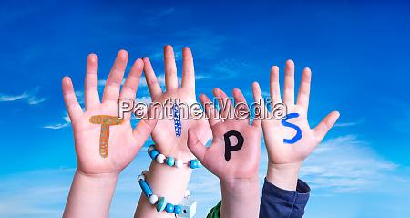 children hands building word tips blue