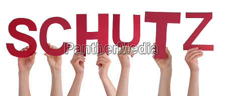 people hands holding word schutz means