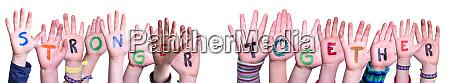 children hands building word stronger together