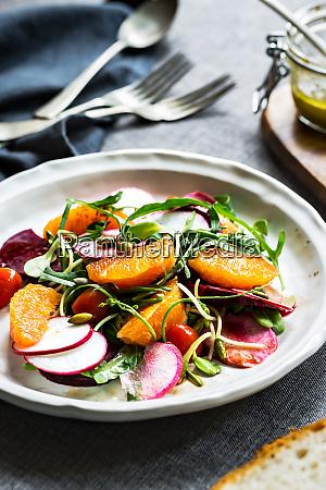 orange with beetroot rocket radish and