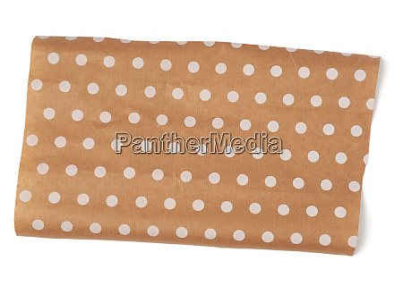 piece of brown paper with white