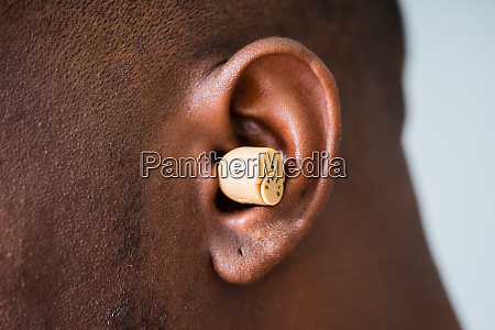 hearing aid on the mans ear