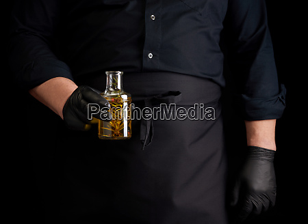 man in black clothes latex gloves