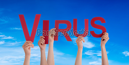 people hands holding word virus blue