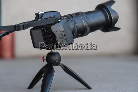 slr camera on a small tripod