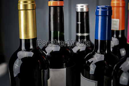 group of bottles of red wine