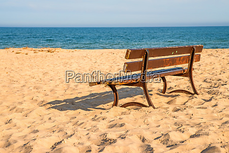 bench on a lonesome beach of
