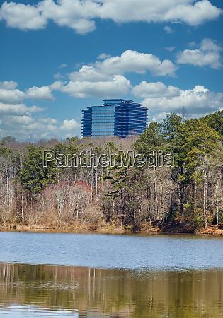 office tower beyond lake