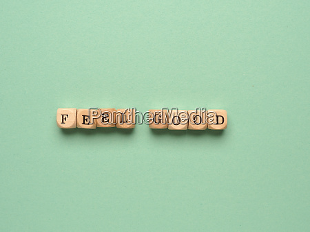 feel good written with small wooden
