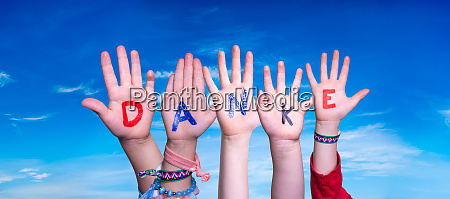 children hands building word danke means