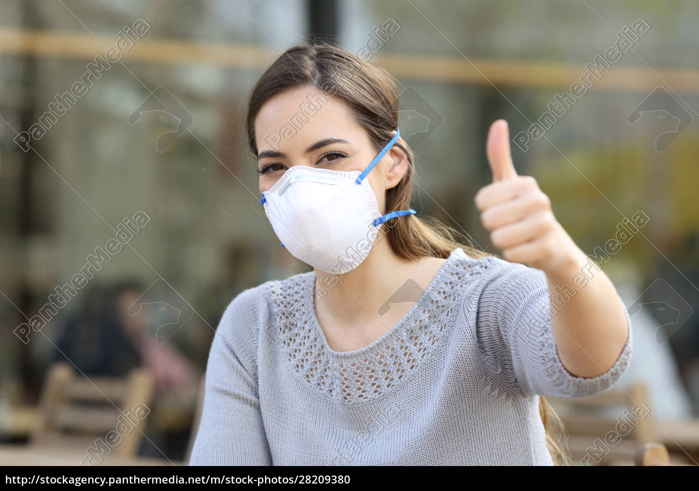woman, doing, thumbs, up, wearing, protective - 28209380