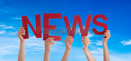 people hands holding word news blue