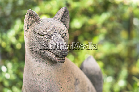 statue of foxes inari deity of