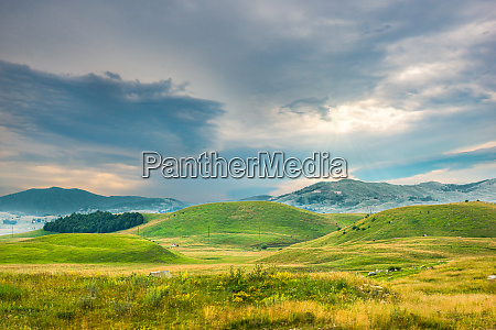 cloudy sky and hills